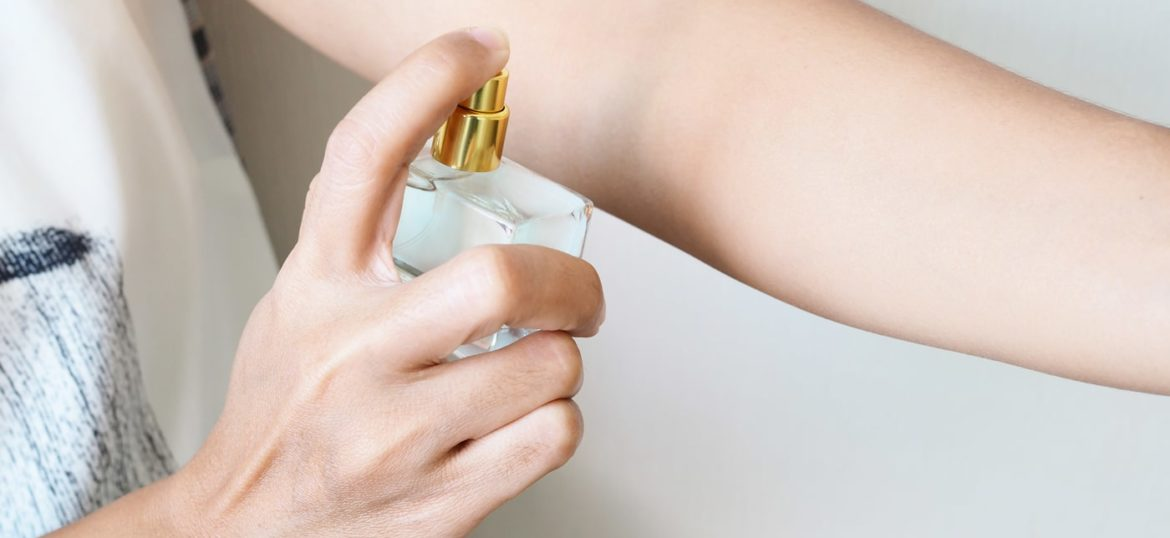 close-up-woman-spraying-perfume-arms-add-fragrance-body