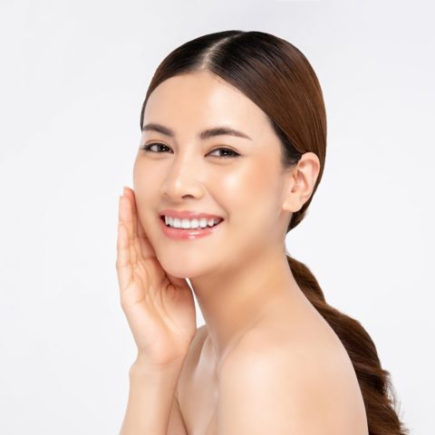 asian-woman-smiling-with-hand-touching-face-beauty-skin-care-concepts